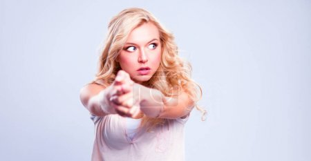Photo for Young emotional woman, isolated on gray background. - Royalty Free Image