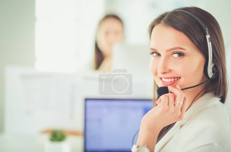 Photo for Smiling businesswoman or helpline operator with headset and computer at office. - Royalty Free Image