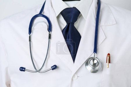 Photo for Medical doctor with a stethoscope standing in office. - Royalty Free Image