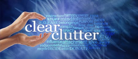 Photo for Make space in your life and clear your clutter - female cupped hands around the words CLEAR CLUTTER surrounded by a relevant tag word cloud on a dark ethereal wispy feather background - Royalty Free Image
