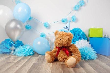 bear toy sitting on floor