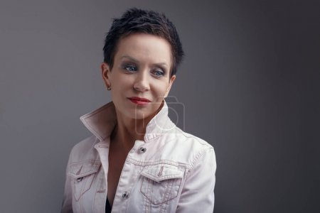 Photo for Studio portrait of beautiful cool middle aged woman with blue eyes - Royalty Free Image