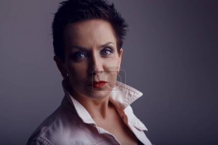 Photo for Studio portrait of beautiful  middle aged brunette woman with blue eyes - Royalty Free Image