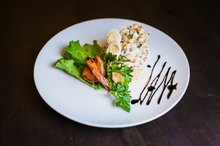 Photo for Russian salad Olivier with shrimps - Royalty Free Image