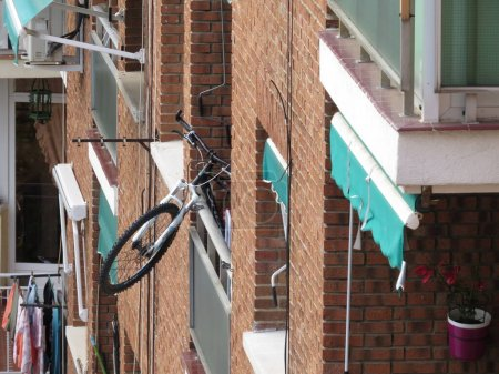 Photo for Bicycle hangs on to window or balcony during Coronavirus emergency isoaltion quarantine as the cyclist cannot go out and ride it - Royalty Free Image