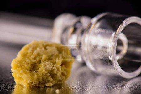 Marijuana extraction concentrate aka wax crumble on dark backgro