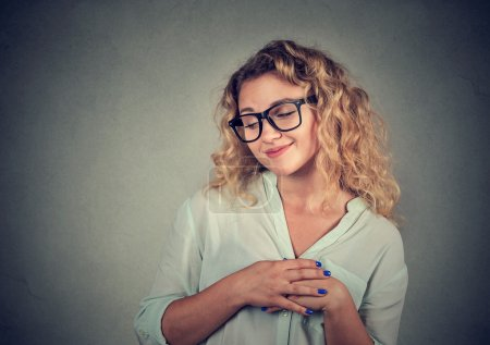 Photo for Lack of confidence. Shy young woman feels awkward isolated on grey wall background. Human emotion body language life perception - Royalty Free Image