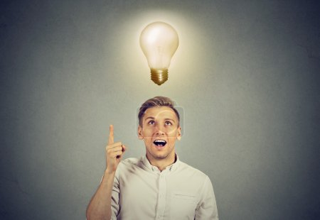 Business man with idea solution and light bulb over head