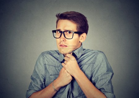Photo for Nervous stressed young man student feels awkward looking at camera anxiously craving something isolated gray wall background. Human emotion face expression feeling body language - Royalty Free Image