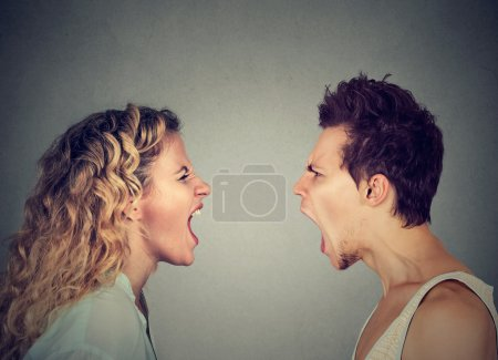 Photo for Angry young couple screaming face to face. - Royalty Free Image