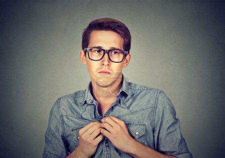 Nervous introvert man feels awkward