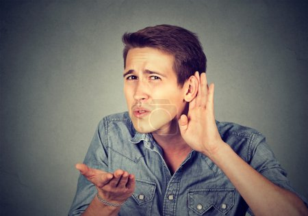 hard of hearing man placing hand on ear asking someone to speak up