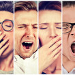 Multiethnic group of sleepy people women and men w...