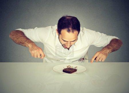 Hungry man craving sweet food pound cake