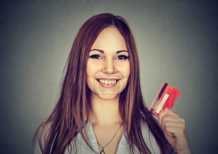 Happy woman shopping holding showing credit card
