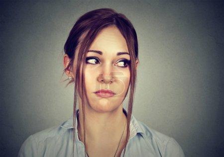 portrait of a sad woman looking sideways