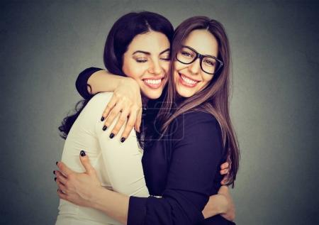 Photo for Best friends two women hugging each other - Royalty Free Image
