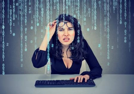 Photo for Confused girl coding on the computer - Royalty Free Image