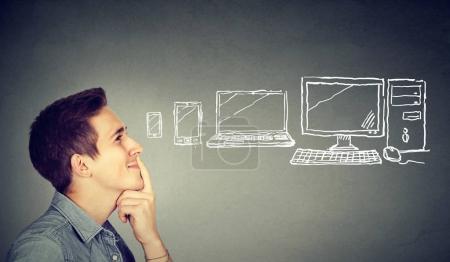 Man choosing a communication gadget