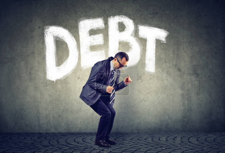Photo for Stressed business man under debt pressure - Royalty Free Image
