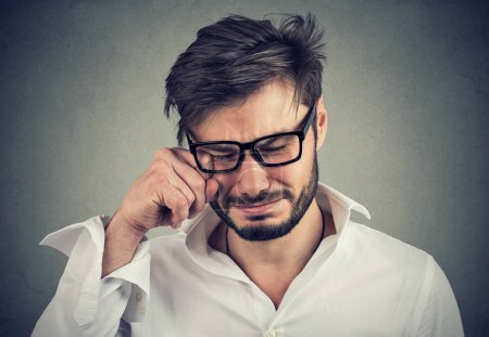 Photo for Closeup portrait of an crying adult man in glasses - Royalty Free Image