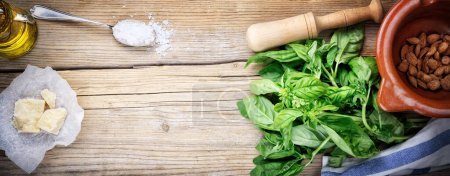 Photo for Basil pesto with almonds, parmesan cheese and extra virgin olive oil, top view, copy space. - Royalty Free Image