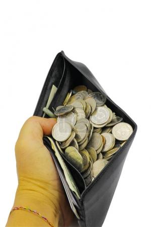 Photo pour Pièce de monnaie dans la bourse sur fond blanc - image libre de droit