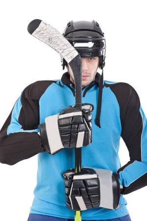 Hockey player on white background.