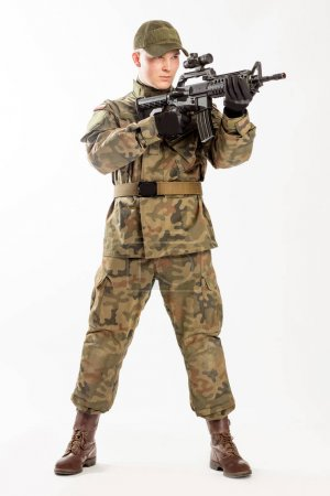 Soldier in military clothes on the white background.