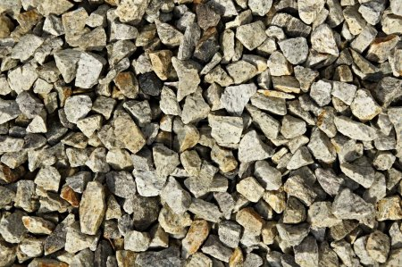 Photo pour Fond de petites pierres grises - image libre de droit