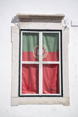 the portugese flag at a window