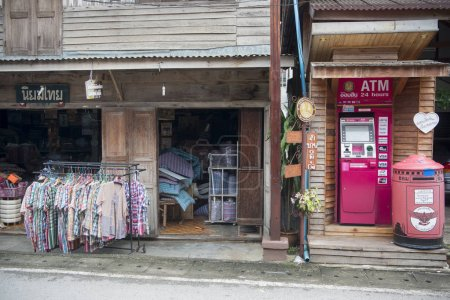 Wooden houses and the evening market in Thailand
