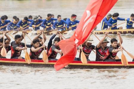 the tradititional Longboat Race at the Mun river of the town of Satuek north of the city Buri Ram in Isan in Northeast thailand. Thailand, Buriram, November, 2017.