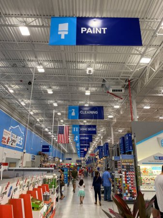 Orlando,FL/USA-9/28/19: The signs hanging from the ceiling at Lowes home improvement store that designate what departments are in the aisle while people shop underneath them.