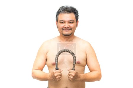 Photo for Asian man 40s fat body from obesity and diabetes tired effort exercise by use Arm Chest Strength Training Spring Power Twister Bar Exercise equipment for healthy and build muscle - Royalty Free Image
