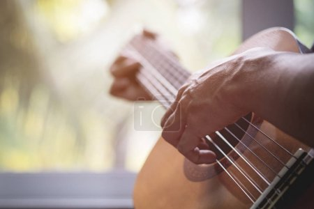 Acoustic guitar guitarist playing. Musical instrument with perfo