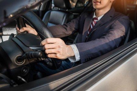 handsome businessman driving sports car