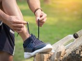 man runner tightening shoe laces,