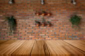 Wood table top on blur green nature background of trees in the p