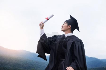 Photo for Graduation Student Commencement University Degree Concept, group of multiracial graduates holding diploma Celebration Education, Success Learning Concept - Royalty Free Image