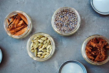 A selection of dried herbs and spices. Use in cooking to add seasoning and flavor to a meal: cinnamon, cardamom, lavender, star anise
