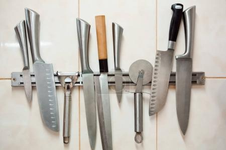 Photo for Set of professional knives: paring, Yanagiba, pizza knife, Santoku, carving knife, universal or chef's knife - Royalty Free Image