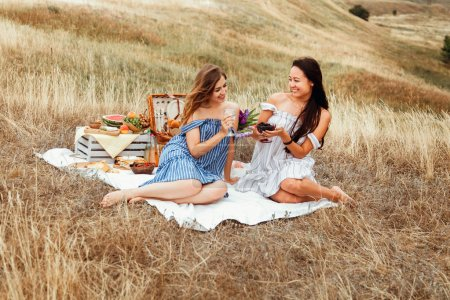 young girls girlfriends on a picnic
