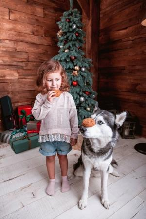 girl play with the dog