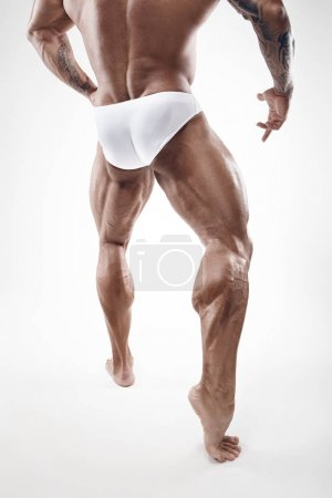 Photo for Strong Athletic Man Fitness Model Torso showing naked muscular legs isolated on white background - Royalty Free Image