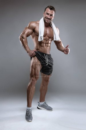 Strong Athletic Man shows body and abdominal muscles