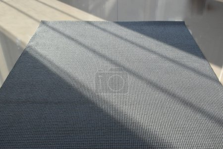 Yoga mat put on floor in side fitness gym, image s...