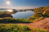 A beautiful magical lake on a summer morning at dawn VII