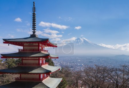 Mt. Fuji volcano viewed from behind red Chureito Pagoda
