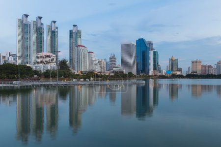 Twilight, city office building with water reflection, Bangkok Thailand